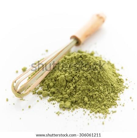 Matcha Green Tea Powder with Stirring Whisk on White Background - stock photo
