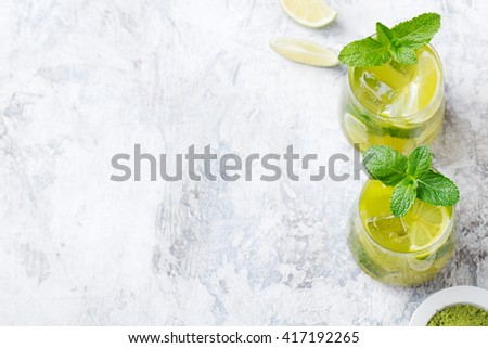 Matcha iced green tea with lime and fresh mint on a marble background Copy space Top view - stock photo