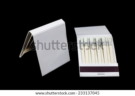 Matchbook on a black background - stock photo