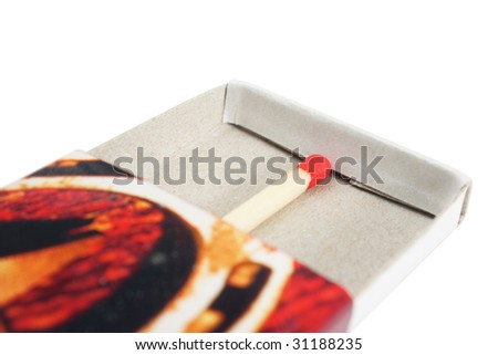 Matchbox with red match isolated over white background - stock photo