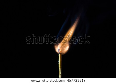 Matches and fire On a black background