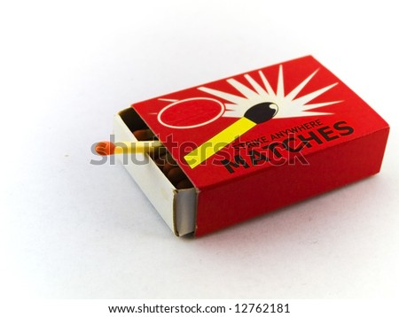 Matches and Matchbox on White Background - stock photo