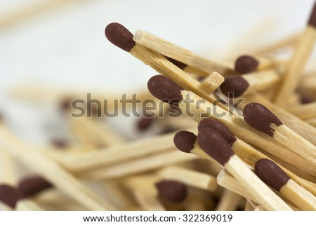 matches lying on each other on a white background in a macro view
