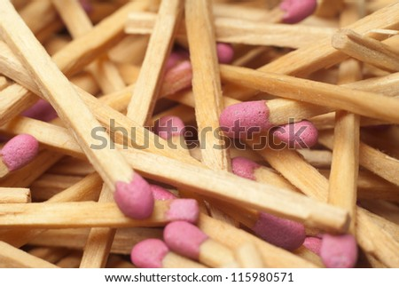 Matches with red heads dispersion in the chaos of close-up - stock photo