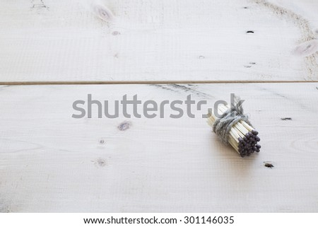 Matches with rope on white table - stock photo