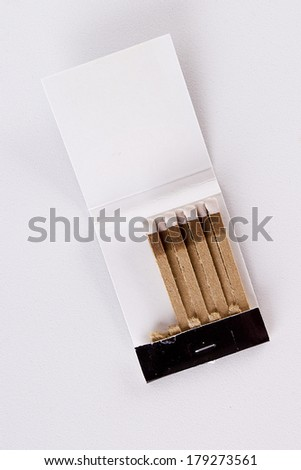 Matches with white work surface for everyday needs. - stock photo