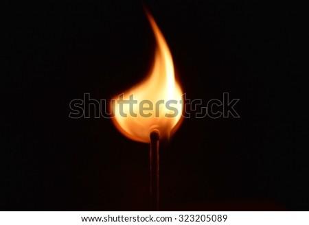 matchstick light in the dark - stock photo