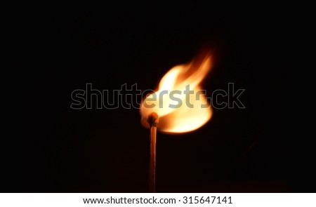 matchstick light up in the dark - stock photo