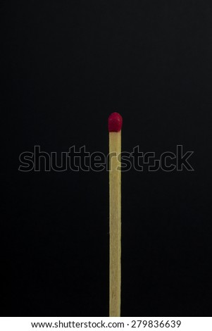 Matchstick on black background