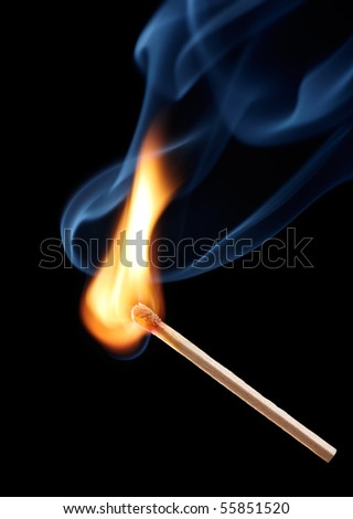 matchstick with flame on black background
