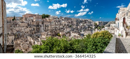 MATERA, ITALY  SEPTEMBER 15, 2014: Panoramic view of Sassi di Matera ancient town from Piazza Duomo. The city is a UNESCO World Heritage site and European Capital of Culture for 2019 - stock photo