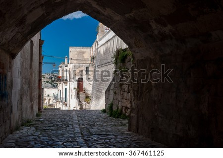 MATERA, ITALY â?? SEPTEMBER 15, 2014: Passage and buildings in ancient town Sassi di Matera. The city is a UNESCO World Heritage site and European Capital of Culture for 2019 - stock photo