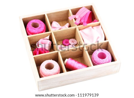 Material for sewing in wooden box isolated on white - stock photo