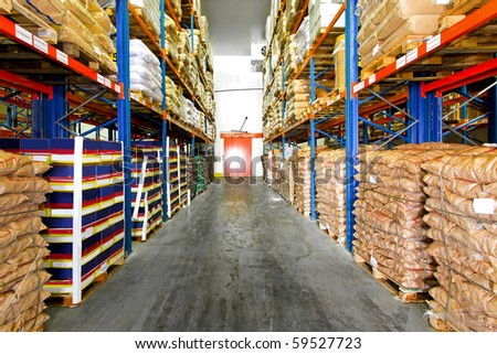 Material in sacks package at shelves of warehouse