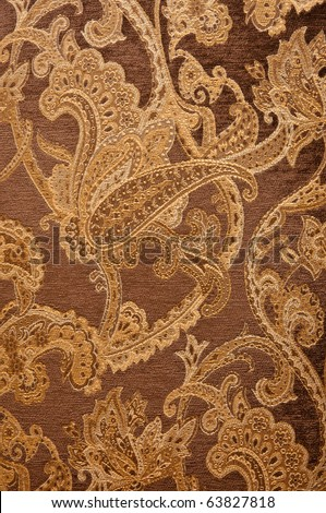 material of brown paisley pattern - stock photo