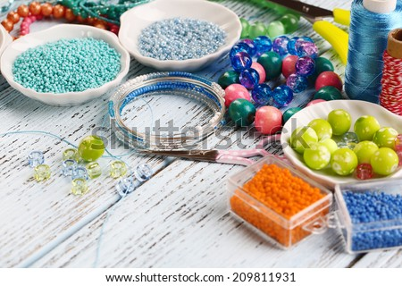 Materials for manufacture of jewelry on table close-up - stock photo