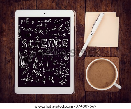 Math equations against students desk with tablet pc. Retro stale. - stock photo