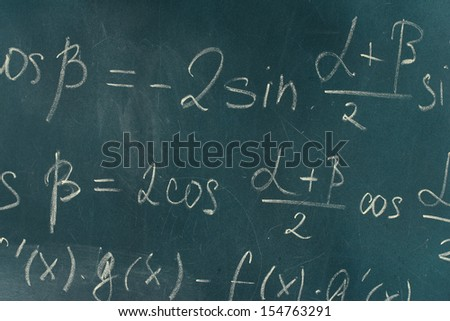 Math formula written on blackboard with chalk. - stock photo