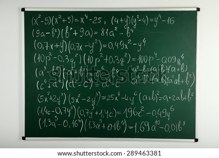 Math formulas on blackboard background - stock photo