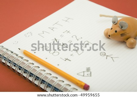 math homework with pencil and wooden toy - stock photo