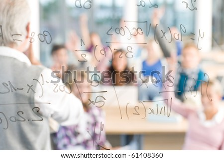 Math lesson at high school - students with professor in classroom - stock photo