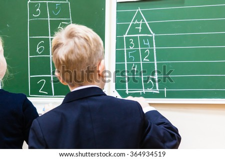 Math lesson at school - stock photo