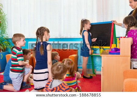 Math lesson with blackboard at kindergarten - stock photo