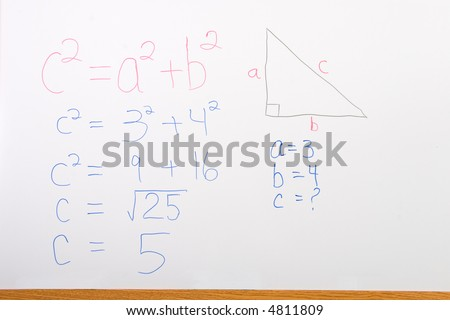 Math problem on whiteboard illustrating pythagorean theorem - stock photo