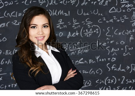 Math teacher in her classroom with chalk board