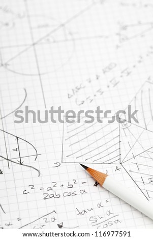 Mathematical notes about geometry and trigonometry with pencil on note paper - stock photo