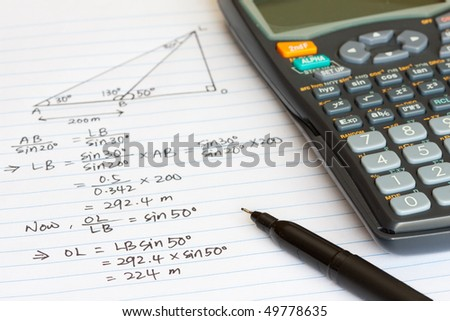 Mathematics equation with a scientific calculator - stock photo