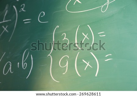 Mathematics formulas on blackboard background - stock photo