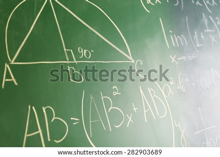 Mathematics formulas on blackboard background - stock photo