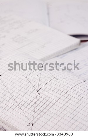 Mathematics home work written at school notebook - stock photo