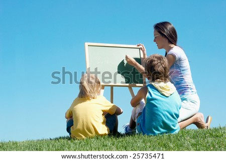 Mathematics lesson on open air - stock photo