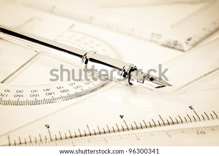 Mathematics rulers with fountain pen - stock photo