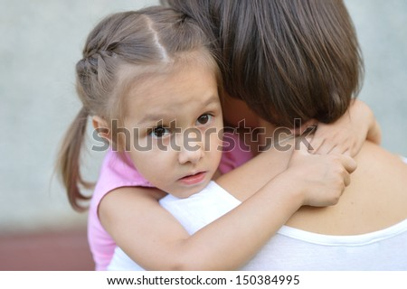 mather with her little daughter in nature - stock photo