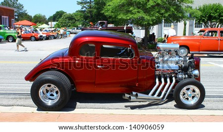 """MATHEWS, VA- JUNE 01:An old Chevy Streetrod in the Annual: Vintage TV's """"Chasing Pavement Vintage Automotive Festival"""" in Mathews, Virginia on June 01, 2013 - stock photo"""