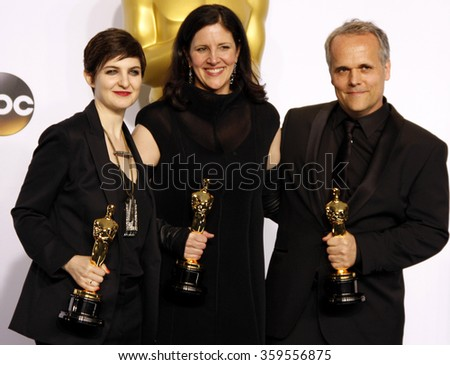 Mathilde Bonnefoy, Laura Poitras and Dirk Wilutzky at the 87th Annual Academy Awards - Press Room held at the Loews Hollywood Hotel in Los Angeles, USA February 22, 2015. - stock photo
