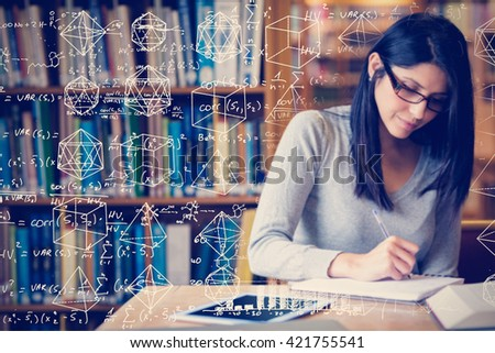 Maths against woman studying in the library - stock photo