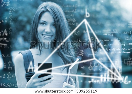 Maths equations against pretty student sending a text outside on campus - stock photo