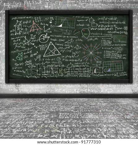 maths formula on chalkboard in classroom - stock photo