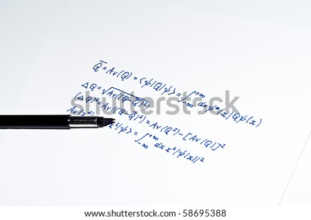 Maths or physics formula and black pen isolated on white background