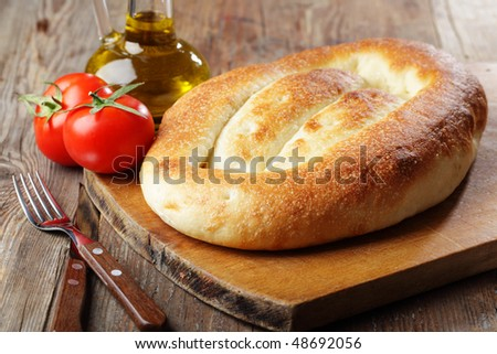Matnakash, traditional armenian bread, with tomatoes and olive oil