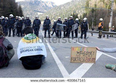 MATREI AM BRENNER, AUSTRIA - 03 APRIL 2016: Moments of tension between no-borders and Austrian police, unprepared for that event, he responds with pepper spray.
