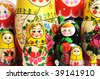 matreshka doll isolated on white Matreshkas Flash Mob - stock photo