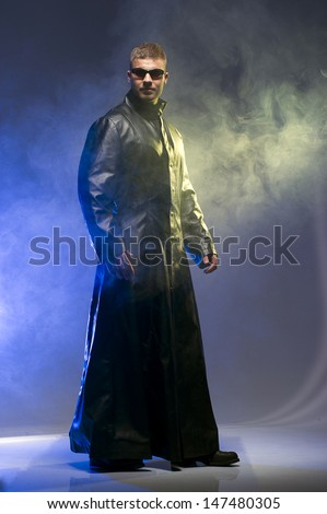Matrix Style Role Play Character Adult Man in Trench Coat - stock photo