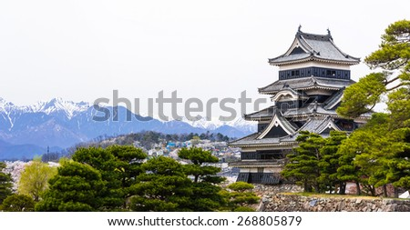 Matsumoto Castle and Japan Alps on the background - stock photo