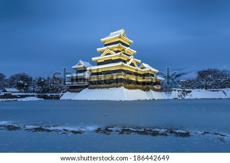 Matsumoto Castle in Winter at Twilight Scene on February 2014, Heavy snowfall in the past 120 years of Japan. - stock photo