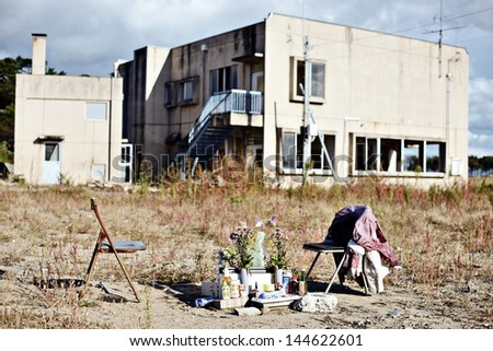 MATSUSHIMA, JAPAN - OCTOBER 29: A small shrine near a destroyed building October 29, 2012 in Matsushima, JP. The area was mostly destroyed in the 2011 Tohoku earthquake and tsunami. - stock photo
